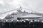 Audience watching raising of USS Witcha (LCS-13) ensign during commissioning ceremony US Navy 190112-N-DA434-157.jpg