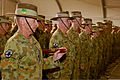 Australian Army Warrant Officer Class One Paul Tyrrell, left, the regimental sergeant major of Combined Team Uruzgan, and fellow team members attend a ceremony transferring authority for the team from Col. Simon 130807-O-MD709-038-AU.jpg