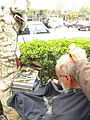 Barber on the sidewalk of a street in Nishapur 2.jpg