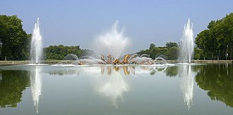 """French formal garden - The """"Basin of Apollo"""" in the Gardens of Versailles."""