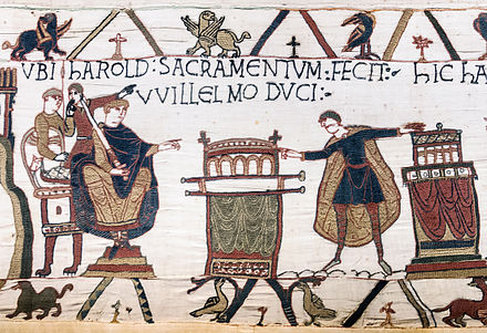 "HAROLD SACRAMENTUM FECIT VVILLELMO DUCI (""Harold made an oath to Duke William""). (Bayeux Tapestry) This scene is stated in the previous scene on the Tapestry to have taken place at Bagia (Bayeux, probably in Bayeux Cathedral). It shows Harold touching two altars with the enthroned Duke looking on, and is central to the Norman Invasion of England. Bayeux Tapestry scene23 Harold sacramentum fecit Willelmo duci.jpg"