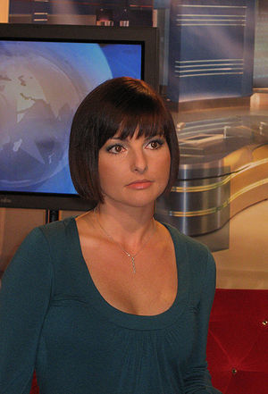 Women in journalism - A news anchor going live on TV in Poland, 2007