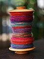 Bobbin with colourful wool 2.jpg