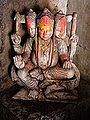 Bodh Gaya - Three-Headed God (9219532807).jpg