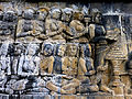 Borobudur - Lalitavistara - 114 E, The Buddha is entertained by Householders (detail 1) (11248660546).jpg