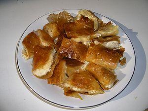 Bougatsa - Sliced cheese-filled bougatsa served on a plate