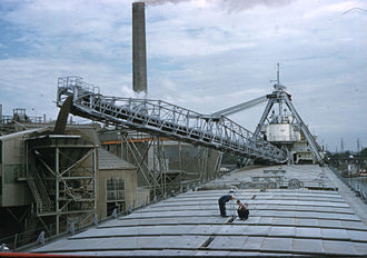 SS Carl D. Bradley - Bradley unloading in a hopper at Michigan Limestone in 1958