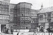 Engraved picture of the courtyard with people in 17th century costume and horses.