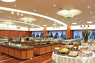 Buffet system of serving meals in which food is placed in a public area where the diners generally serve themselves