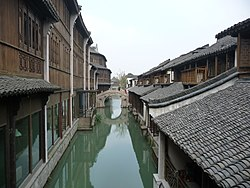 "The canals of Wuzhen have led to it being nicknamed the ""Venice of the East""[۱]"