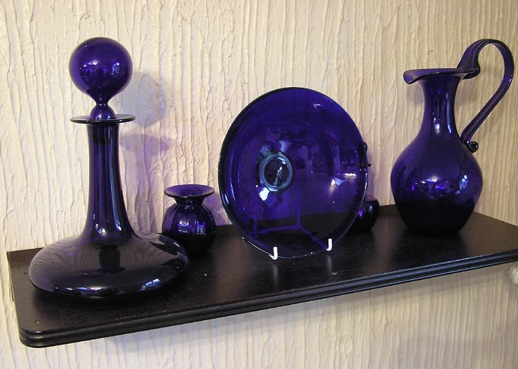 shelf with blue glass vessels