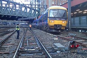 Derailment - A derailed British Rail Class 165 at London Paddington station. The train passed over a set of trap points which caused the derailment. After derailing, the rear of the train struck a stanchion, severely damaging the driver's side of the rear unit.