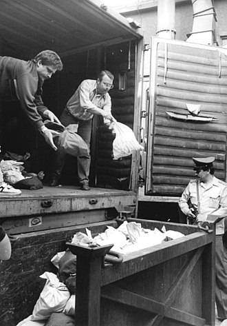 East German mark - Unloading sacks of coins from the Staatsbank for melting down, 1990.
