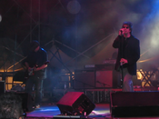 Colour photograph of Echo & the Bunnymen performing live in 2006