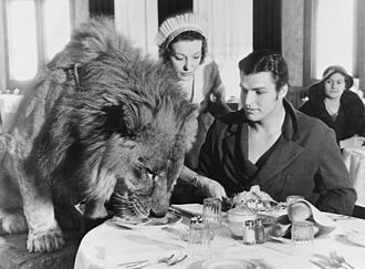 Buster Crabbe - Crabbe and lion Jack, one of his partners in King of the Jungle, are having a lunch in a Hollywood restaurant on February 6, 1933. Crabbe became a lion tamer while working on that film.