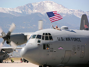 302d Airlift Wing - Wing C-130 Hercules with Pikes Peak in the background