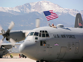 302d Operations Group - Lockheed C-130 with Pikes Peak in the background