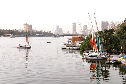 The river Nile flows through Cairo, here contrasting ancient customs of daily life with the modern city of today Cairo Nile River.jpg