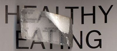 A calcite crystal laid upon a paper with some letters showing the double refraction