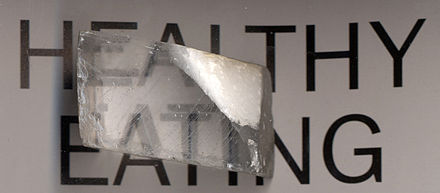 A calcite crystal laid upon a paper with some letters showing double refraction Calcite.jpg