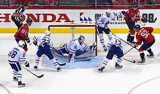 Ice hockey - The Toronto Maple Leafs (white) defend their goal against the Washington Capitals (red) during the 2016–17 NHL season.