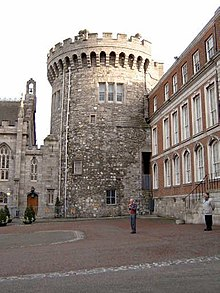 The Record Tower, the sole surviving tower of the medieval castle dating  from c.1228. To its left is the Chapel Royal.