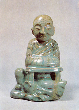 Celadon Seated Arhat with Underglaze White Slip
