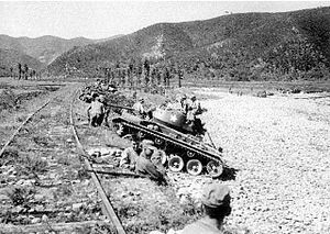 M24 Chaffee - M24 Chaffee light tanks of the 25th Infantry Division, U.S. Army, wait for an assault of North Korean T-34-85 tanks at Masan.