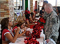 Cheerleaders sign autographs 111215-A-KJ276-001.jpg