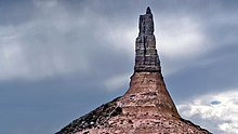 A thin pillar of rock juts upwards.