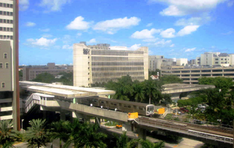 Civic Center station (Metrorail) - View from the UM/Jackson medical complex and Metrorail train entering the station