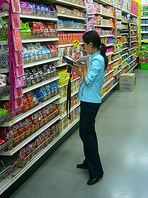 Female clerk doing inventory work using a hand...