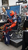 Comic Con Brussels 2016 - Deadpool on the Iron Throne (26675225495).jpg