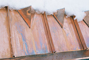 Snow guard - Copper Armor Panel Guard demonstrating snow retention on a copper roof.