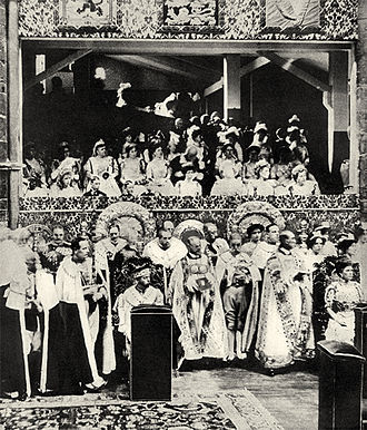 "Coronation of King George V and Queen Mary - ""King George V and Queen Mary occupying their chairs of estate on the south side of the altar during that part of the coronation service which precedes the anointing"". An official photograph by Sir John Benjamin Stone (1838 – 1914)."