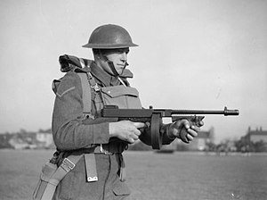 Lance corporal - A lance corporal of the East Surrey Regiment, British Army equipped with a Thompson M1928 submachine gun (drum magazine), 25 November 1940