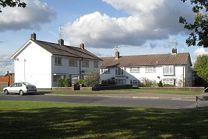 "Crawley Development Corporation - Most of the Corporation's housing stock consisted of ""Group I"" houses.  Many were terraced or semi-detached, as here at Paddockhurst Road in Gossops Green."