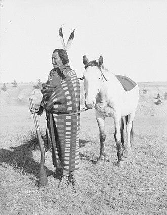 "Remington-Keene rifle - ""Crow Dog"", a Brulé Native American, with a Remington-Keene rifle, ca. 1898."