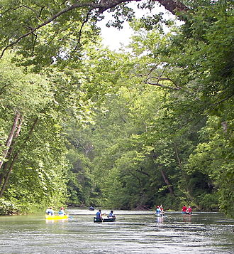 Ozark National Scenic Riverways - Canoers float the Current River below Welch Spring, which contributes on average 121 cubic feet (3.5 m3) of water per second to the flow of the river.