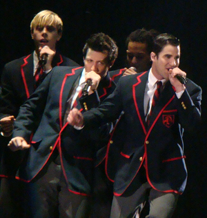 """Never Been Kissed (Glee) - The Dalton Academy Warblers performing """"Teenage Dream"""" on the 2011 Glee Live! In Concert! tour, led by Blaine (front right)."""