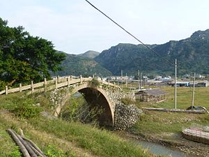 Zhejiang - A restored Qing era (1891) bridge on a coastal road