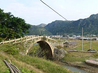 Zhejiang - A restored Qing era (1891) bridge on a coastal road