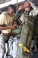 Defense.gov News Photo 100915-A-5820L-0176 - A jumpmaster with the 2nd Brigade Combat Team 82nd Airborne Division checks the equipment of a paratrooper before an airborne operation to start.jpg