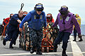 Defense.gov News Photo 110312-N-CP762-2100 - U.S. Navy sailors aboard the U.S. 7th Fleet flagship USS Blue Ridge LCC 19 move pallets of humanitarian assistance disaster relief kits across the.jpg