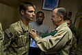 Defense.gov News Photo 110801-N-TT977-122 - Chairman of the Joint Chiefs of Staff Adm. Mike Mullen presents the Purple Heart to U.S. Army Spc. Preston M. Hodge at Bagram Air Base.jpg