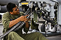 Defense.gov News Photo 111116-M-OO345-002 - U.S. Marine Corps Cpl. Ceasar Vargas installs a link less feed system onto an AH-1Z Super Cobra helicopter aboard the USS Makin Island underway in.jpg