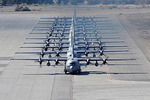 "Elephant walk (aeronautics) - An ""Elephant Walk"" of C-130 Hercules at  Nellis Air Force Base, 2009"