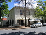 The Devonshire House is situated on the oldest street corner of Stellenbosch and was erected here in about 1861. It is a double-storeyed townhouse in the early Victorian style.