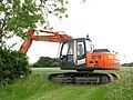 Digger parked at the end of a farm track - geograph.org.uk - 1342532.jpg