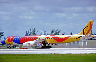 Braniff International Airways - Braniff Douglas DC-8-62 wearing Alexander Calder's Flying Colors of South America design at Miami Airport in August 1975